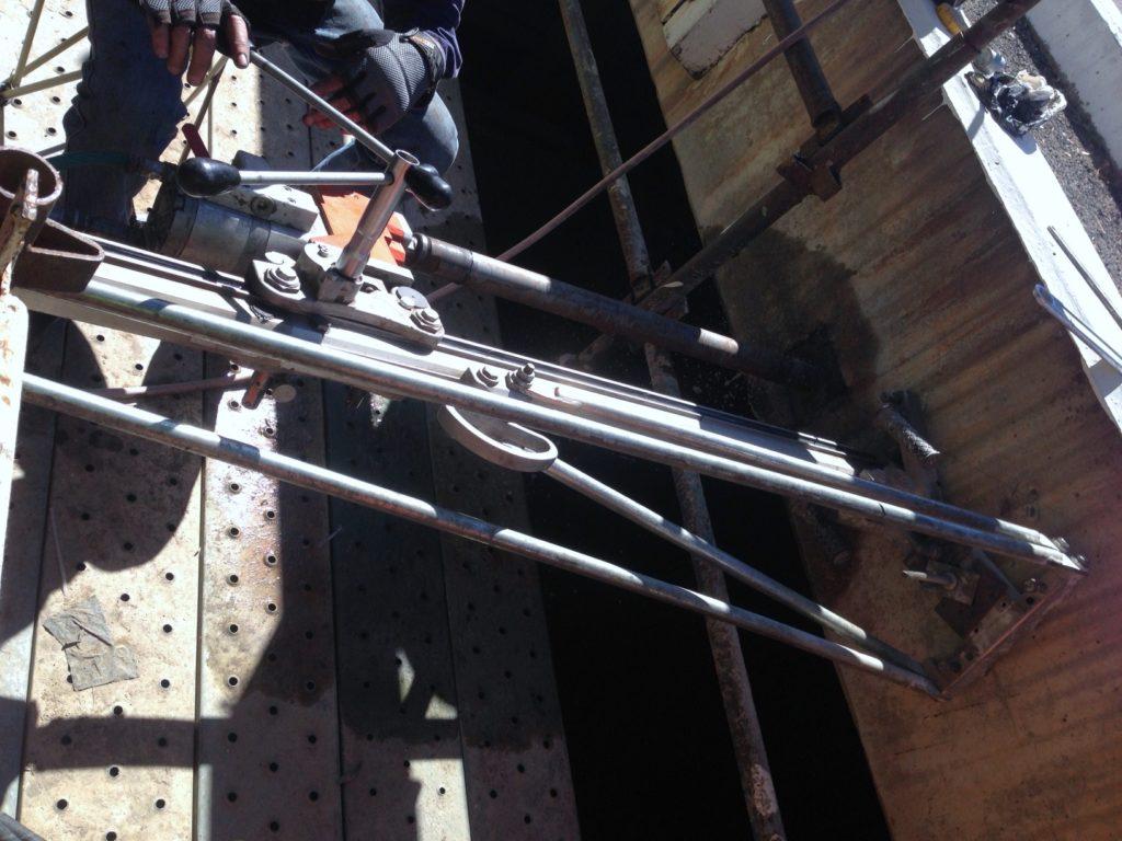 Core hole through bridge beams (65mm dia 11m deep)